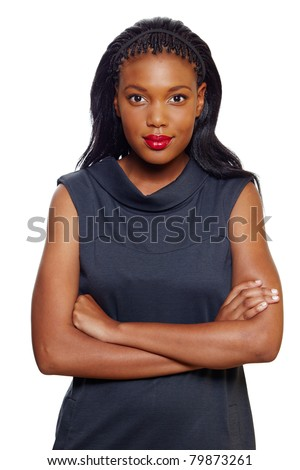 Portrait of a happy African American business woman with hands folded on white