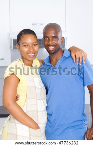 portrait of a happy african american couple in kitchen