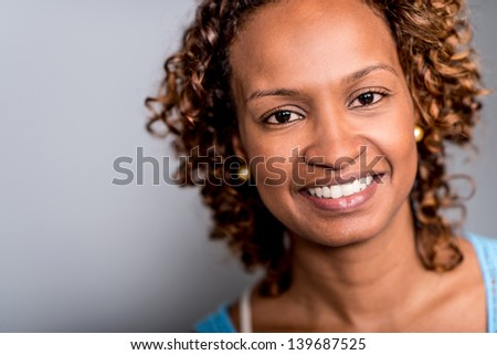 Portrait of a happy African American woman - stock photo
