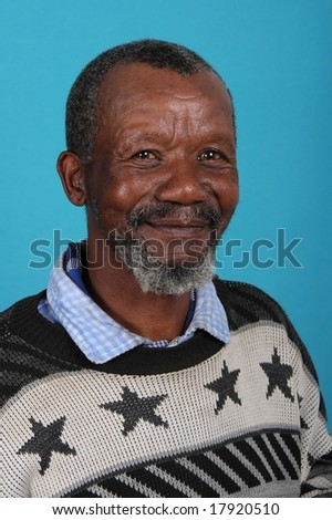 Portrait of a happy African man against a blue background - stock photo