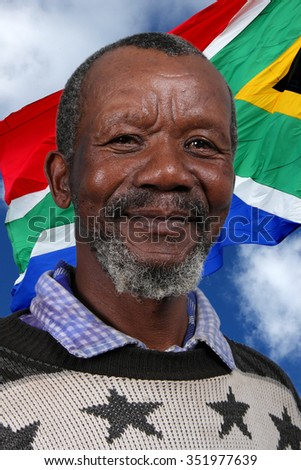 Portrait of a happy African man against the South African flag
