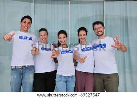 portrait of a happy and cheerful volunteer group - stock photo