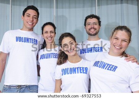 portrait of a happy and diverse volunteer group - stock photo