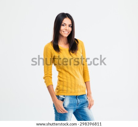 Portrait of a happy attractive woman in casual cloth standing isolated on a white background and looking at camera - stock photo