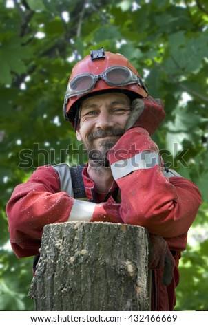 Portrait of a happy bearded Russian arborist - stock photo