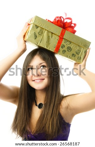 portrait of a happy beautiful girl holding a present on her head - stock photo