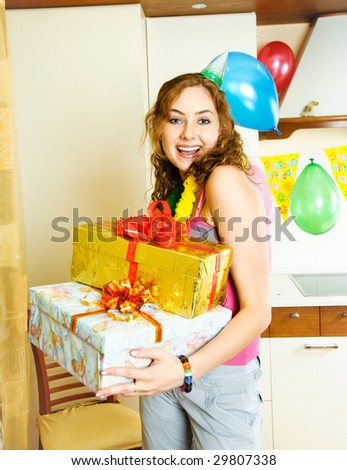 portrait of a happy beautiful girl with a lot of presents celebrating her birthday