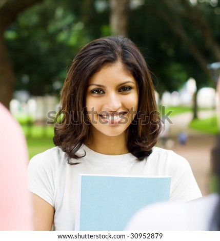 portrait of a happy beautiful indian college student - stock photo