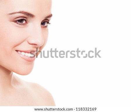 portrait of a happy beautiful smiling woman, isolated against white background, copyspace for your text to the right - stock photo