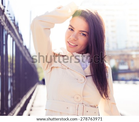 Portrait of a happy beautiful woman posing outdoors