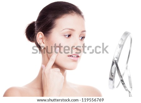 portrait of a happy beautiful woman touching her cheek, isolated against white background - stock photo