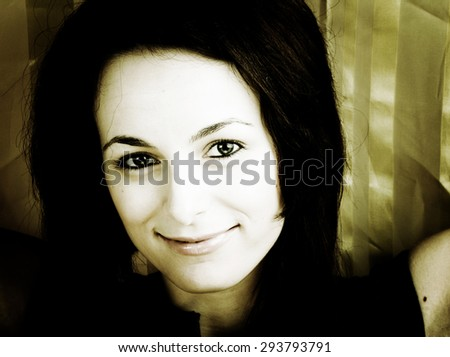 Portrait of a happy beautiful woman with green eyes. - stock photo