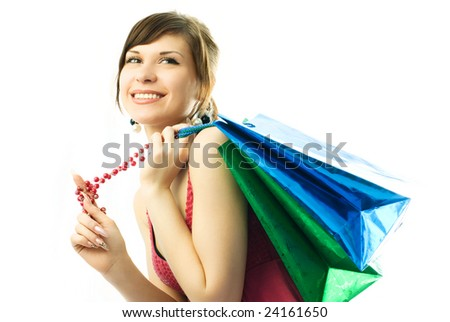 portrait of a happy beautiful young woman with shopping bags - stock photo