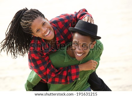 Portrait of a happy black couple smiling outdoors - stock photo