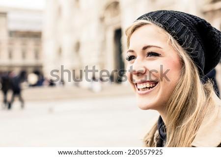 Portrait of a happy blonde woman - stock photo