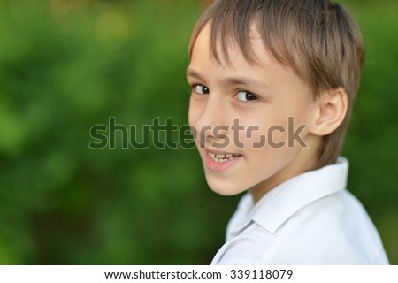 Portrait of a happy  boy in the park - stock photo