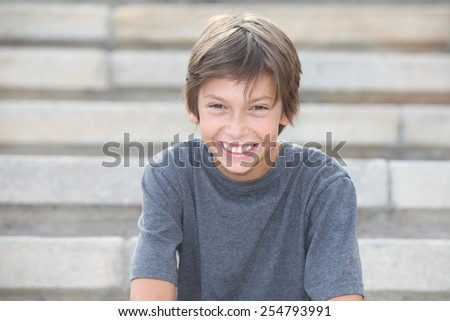 portrait of a happy boy outdoors - stock photo