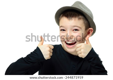 Portrait of a happy boy showing thumbs up on white background  - stock photo