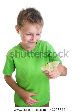 Portrait of a happy boy with a butterfly moon  on her arm - stock photo