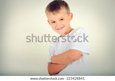 Portrait of a happy boy with blue eyes - stock photo