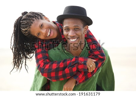 Portrait of a happy boyfriend and girlfriend smiling outdoors - stock photo