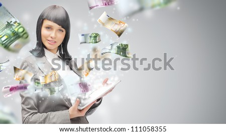 Portrait of a happy brunette woman with tablet computer - money - stock photo