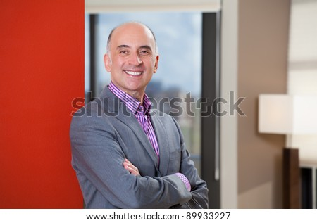 Portrait of a happy business man - stock photo