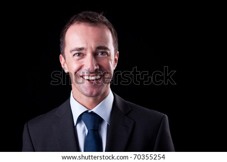 Portrait of a happy  business man isolated on black background. Studio shot. - stock photo