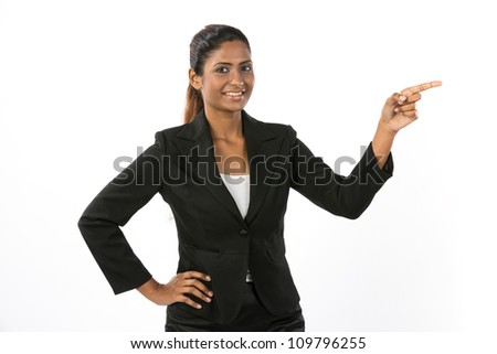 Portrait of a Happy business woman pointing her finger to your message. - stock photo