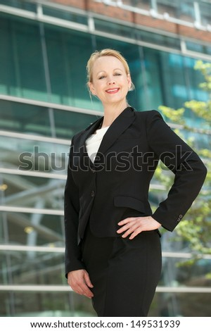Portrait of a happy business woman standing outdoors