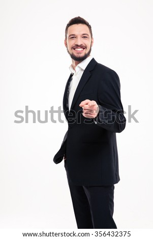 Portrait of a happy businessman pointing finger at camera isolated on a white background - stock photo