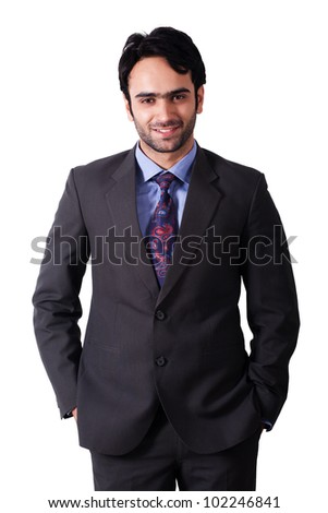 portrait of a happy businessman with his hands in the pockets - stock photo