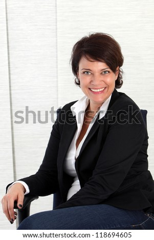 Portrait of a happy Businesswoman in a close up shot - stock photo