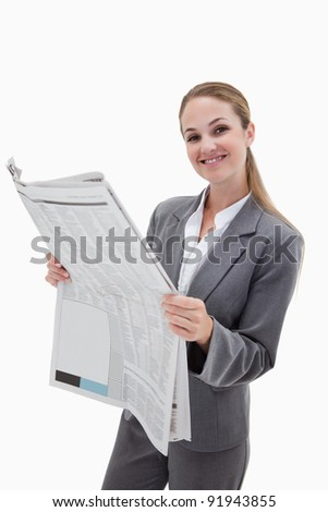 Portrait of a happy businesswoman reading the news against a white background