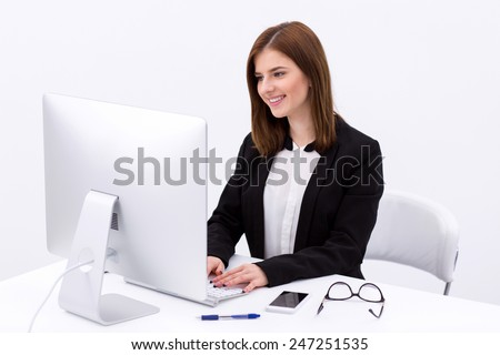 Portrait of a happy businesswoman working in the office - stock photo