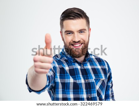 Portrait of a happy casual man showing thumb up isolated on a white background  - stock photo