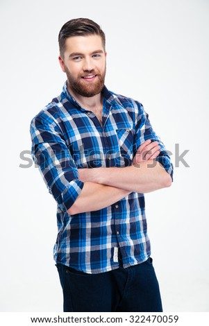 Portrait of a happy casual man standing with arms folded isolated on a white background - stock photo