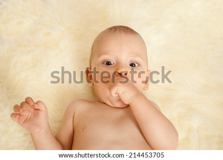 portrait of a happy caucasian adorable baby boy - stock photo