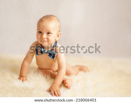 portrait of a happy caucasian adorable baby boy with tie - stock photo