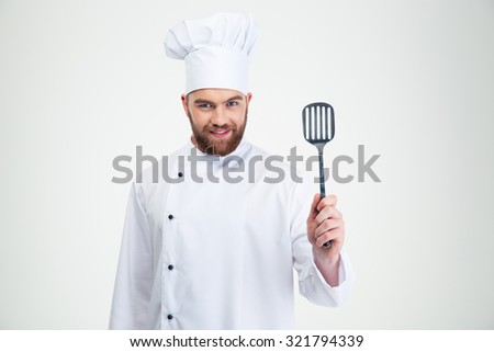 Portrait of a happy chef cook holding spoon isolated on a white background - stock photo