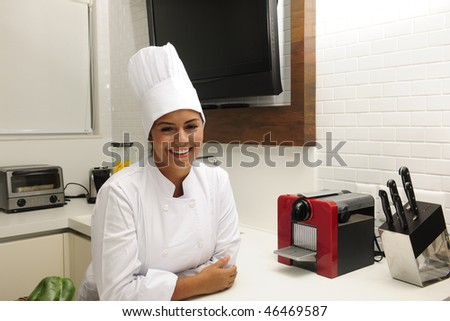 Portrait of a happy chef  cooking in kitchen - stock photo
