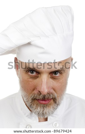 Portrait of a happy chef in a chef's hat.