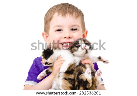 Portrait of a happy child with kittens in the hands isolated on white background - stock photo