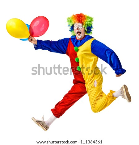 Portrait of a happy clown jumping with balloons. Isolated over white