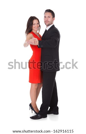 Portrait Of A Happy Couple Dancing On White Background
