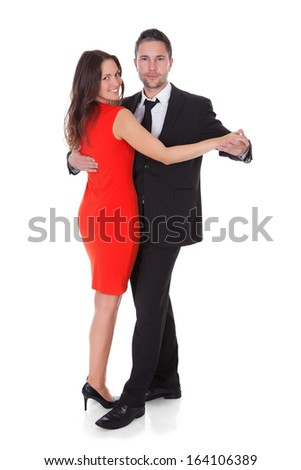 Portrait Of A Happy Couple Dancing On White Background - stock photo