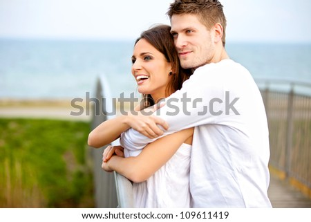 Portrait of a happy couple embracing while in the park - stock photo