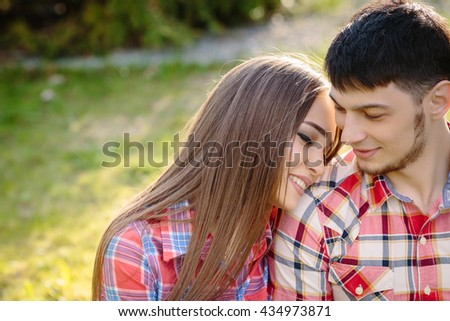 Portrait of a happy couple hug close up grass background - stock photo