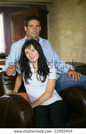 Portrait of a happy couple in an armchair