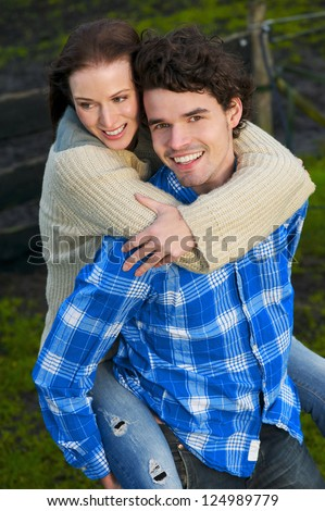 Portrait of a happy couple smiling outdoors - stock photo